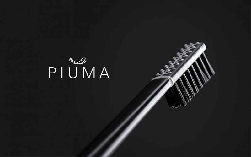 The logo and a detail of the Piuma toothbrush designed by Hangar Design Group