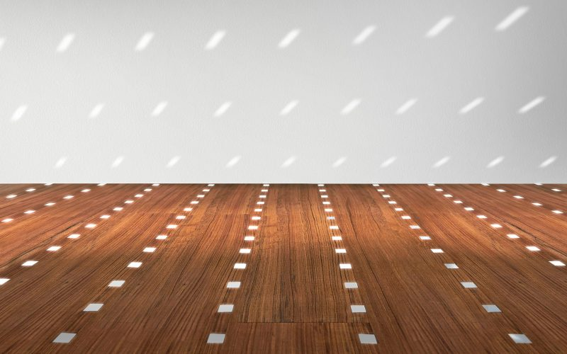 Details in shiny metal designed of Hangar Design Group enrich the wooden floor.